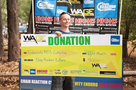 Lindsay Alsop of the Kalamunda Mountain Bike Collective accepting the cheque from WA Gravity Enduro for $900!